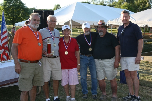 The Kingwood Champs team finished in fourth. From left are Ken Reis, John and Lucille Deo, and John Martarazzo of Kingwood Champs; John Rettura, tournament director; and William Davis, the deputy director of the county's Parks & Recreation Department.