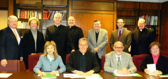 The committee members behind the Sixth Annual Vocations Golf Classic gather to discuss the upcoming event. The classic will benefit the Saint John Vianney Endowment and will be held Monday, July 13, at Blue Ridge Trail Golf Club, Mountaintop.