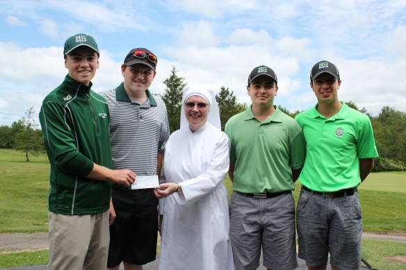 Members of the 2014-2015 Holy Cross High School golf team presented a donation on behalf of the student body of Holy Cross High School to Sister Maureen, l.s.p., at the Little Sisters' golf tournament. Pictured from left: Ryan McDonald, Tommy Dzwonczyk, Sister Maureen, l.s.p., Angelo Mancinelli and Dom Mancinelli.