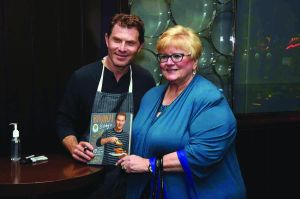 "Dunmorean food editor Cheryl Radkiewicz chats with Bobby Flay during his recent book signing at Savor Borgata.  Flay's book, ""Brunch at Bobby's"", features 140 recipes for the best part of the weekend."